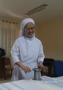 Sister Arcelita Sarnillo of the Sisters of St. Paul de Chartres demonstrates the needle cutter she herself designed to properly dispose of used needles in their hospital.