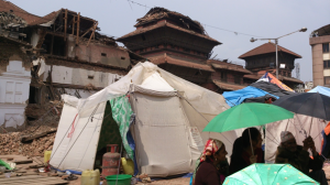 Displaced residents living in tents in historic Kathmandu Durbar Square. Credit: Stringer/HCWH