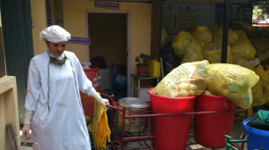 Healthcare waste worker collecting infectious waste for treatment at a major Kathmandu hospital. Waste generation more than doubled in the days after the earthquake. Credit: Stringer/HCWH